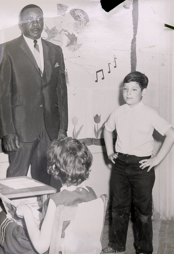 Mike Feldman, 8, stands at the head of the class with boxer Sonny Liston when the former heavyweight champion visited Feldman's school in Poland while he was in Maine to fight Muhammad Ali in 1965.