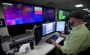 A specialist works at the National Cybersecurity and Communications Integration Center (NCCIC) in Arlington, Va., in 2014.