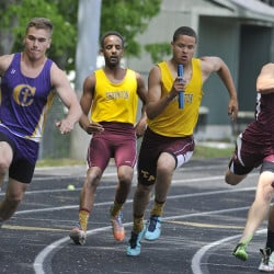 June 6: Class A state championship track meet at Mount Ararat High School. Thornton Academy's takes the baton from a teammate on the third leg of the 100 meter relay and went on to help his team win the event.  John Ewing/Staff Photographer