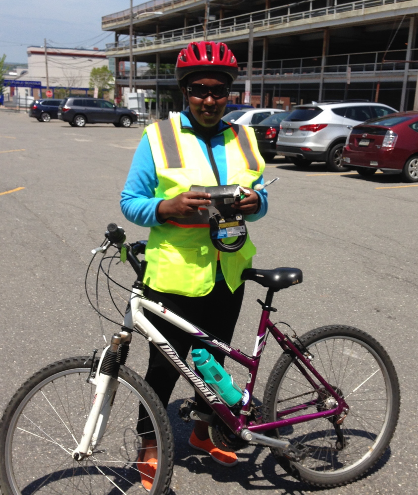 Eugenie Mydear participates in Bikes for New Mainers, which provides immigrants with bike-riding and safety lessons as well as a used bike – the only means of transportation some have.