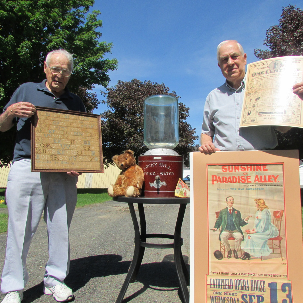 Local antique collector Arthur Julia, left, and Fairfield Historical Society President Doug Cutchin are seen with items that Julia donated to the society recently for its collection of items from Fairfield.