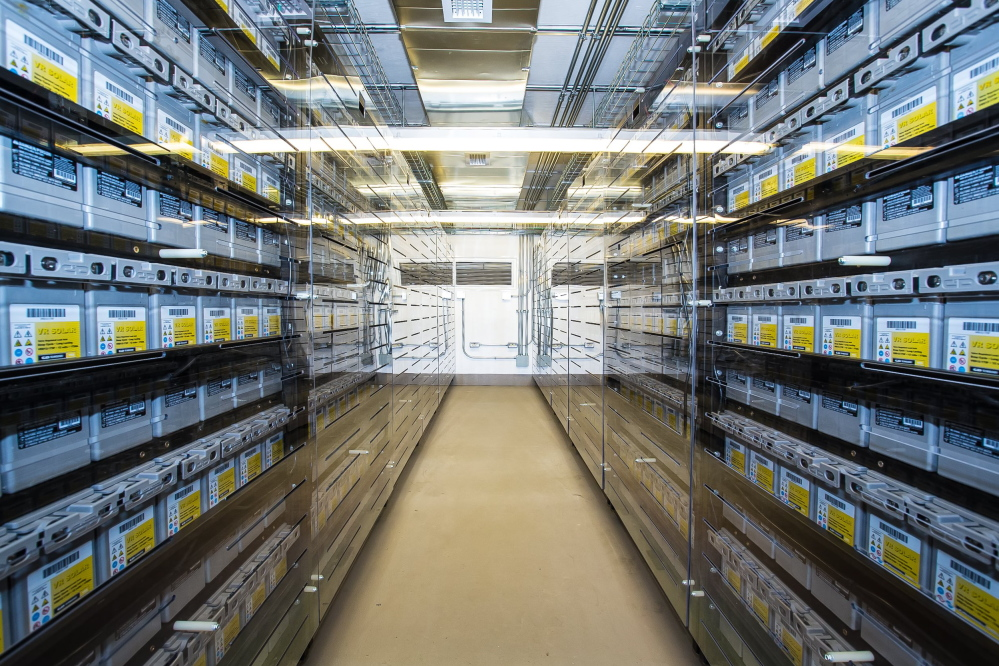 Hundreds of special-purpose batteries fill racks inside one of three shipping containers in Boothbay that make up New England's first utility-scale electricity storage system.