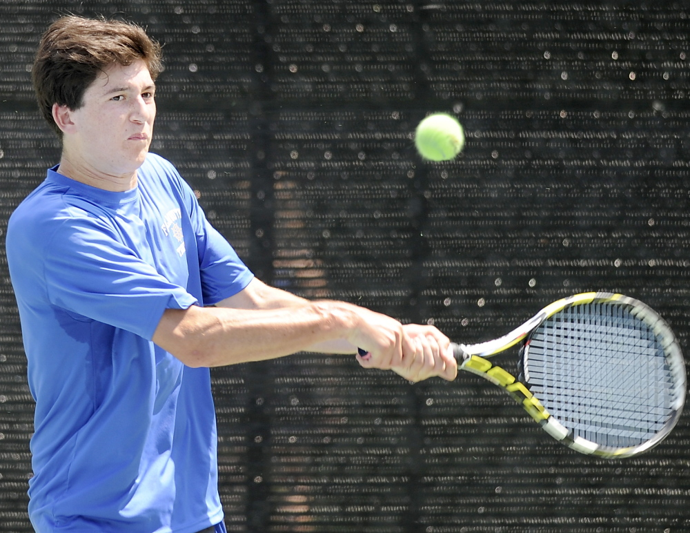 Alex Klemperer, the No. 2 singles player for Falmouth as a freshman, returns a volley to Carlos Jimenez of Thornton Academy during Jimenez's three-set victory Thursday. Klemperer is part of a team that will meet Mt. Ararat on Saturday in an attempt to win a second straight Class A state championship.