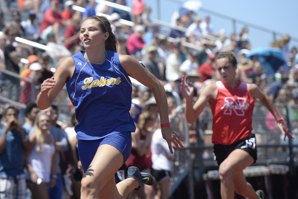 Kate Hall of Lake Region competes in the 100-meter dash at the New England Track and Field Championships at Thornton Academy in Saco on Saturday. Hall won in 11.41 seconds.