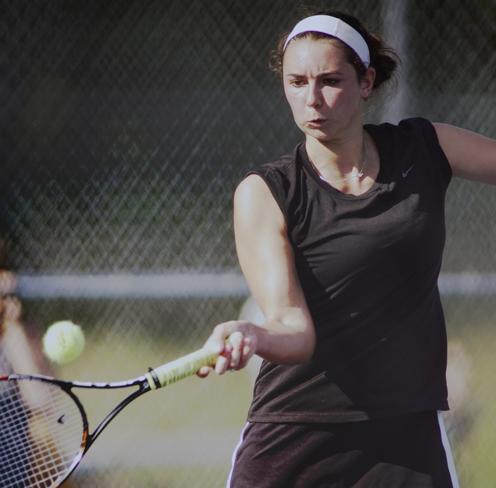 Lena Rich of North Yarmouth Academy returns a shot during her 6-0, 6-2 victory against Courtney Parent of Van Buren in the No. 1 singles match during NYA's 5-0 victory.