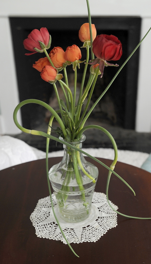 Extra scapes? They make an artful addition to a flower arrangement.