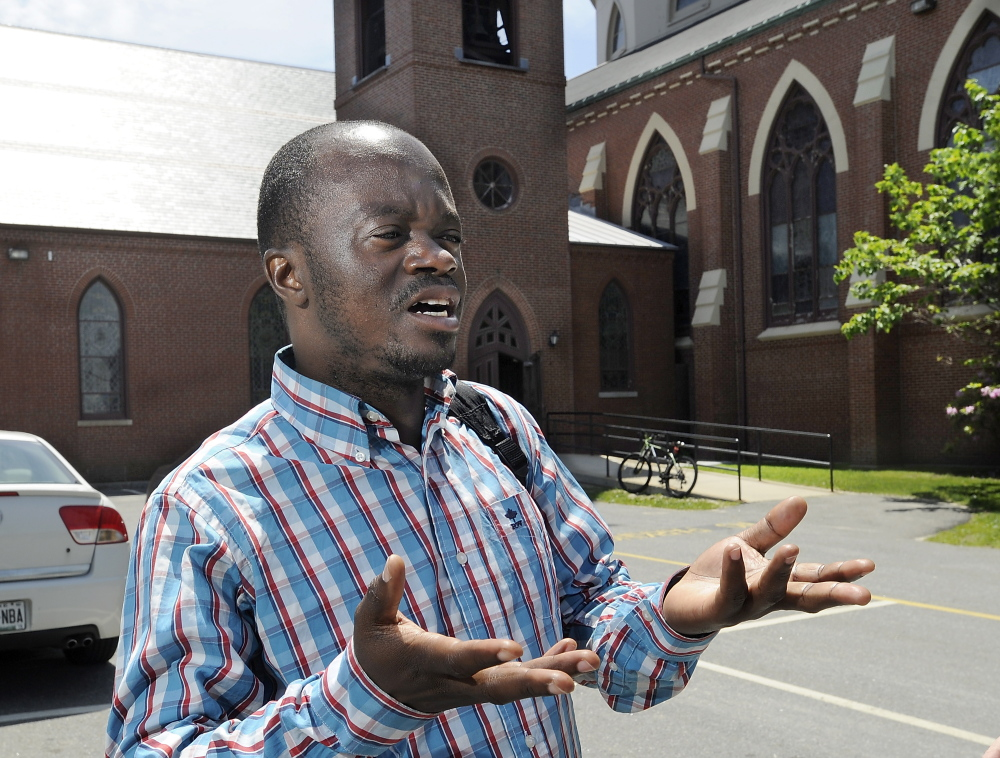 "Franck Yayembe, a Portland resident who is from the Democratic Republic of the Congo, standing outside the Cathedral of the Immaculate Conception in Portland, said of the pope's letter: ""It's a good message."""