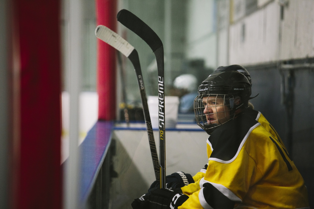 "Gibson Fay-LeBlanc watches the action from the bench during a recent game at the Portland Ice Arena. He's working on a collection of hockey-themed poems that will be called ""Deke.""  Whitney Hayward/Staff Photographer"