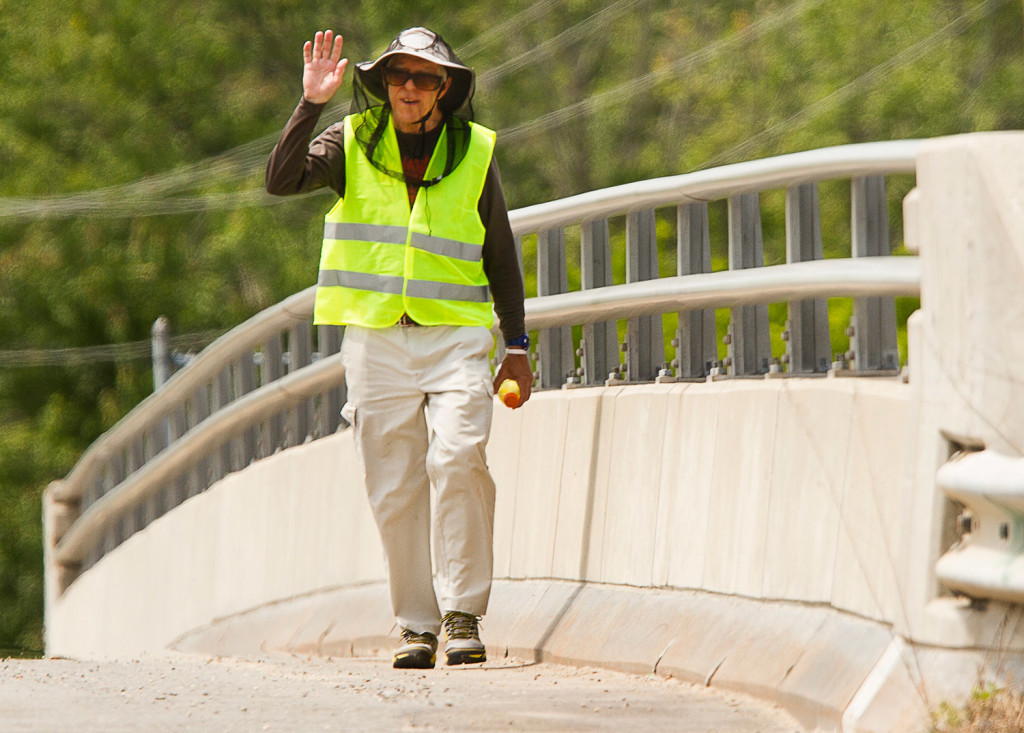 Ray Shevenell waves to motorists as he completes the last few miles of his walk Friday on South Street in Biddeford. Carl D. Walsh/Staff Photographer
