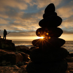 Professional photo guide Vincent Lawrence of Seal Harbor, Maine, left, and his client Frank Gallagher, of Silver Spring, Md., move to a new position while photographing the rocky coast of Maine's Acadia National Park at dawn, Friday, Oct. 3, 2014. The Associated Press