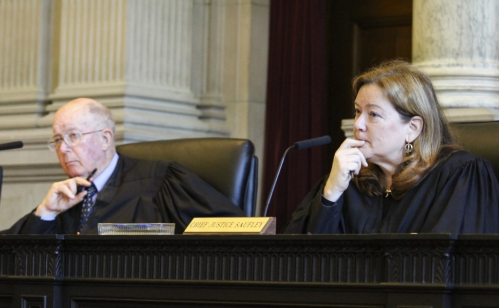 Chief Justice Leigh Saufley, right, joined by Justice Donald Alexander, listen to arguments before the Maine Supreme Judicial Court, Friday during a hearing on the issue of LePage's attempt to veto 65 bills after lawmakers said they already became law. Joel Page/Staff Photographer