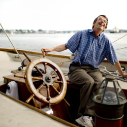 Alex Agnew, president of Sailing Ships Portland, hangs out on the schooner Bagheera at the Maine State Pier. The nonprofit hopes to provide at least 50 scholarships a year so high school students can go to sea and learn about sailing.