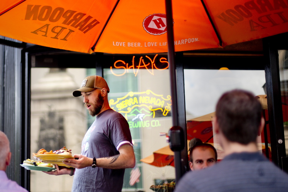 """At work Thursday, Sylvan Vogel, a 31-year-old bartender at Shay's Grill Pub in Portland, said he worries that some restaurants wouldn't be able to afford the increase in wages under proposals the city is considering. """"It's not an easy business,"""" Vogel said."""