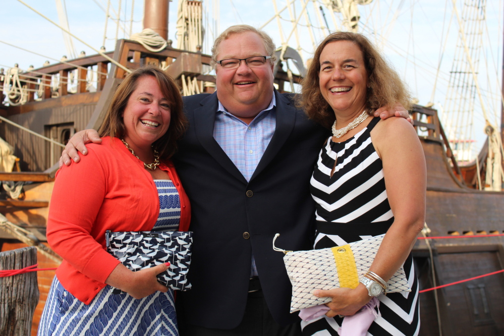 Katie Hatch, executive director of SailMaine, with founder Chris Robinson and his wife Maggie, team parent of the Falmouth High School sailing team.