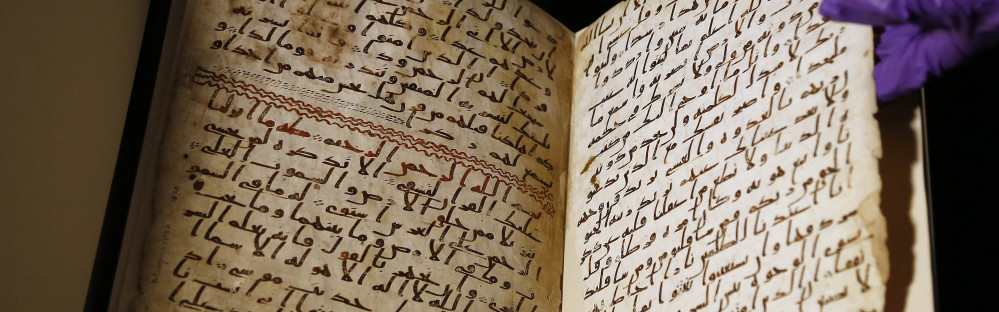 A university assistant shows fragments of an old Quran at the University in Birmingham in central England.
