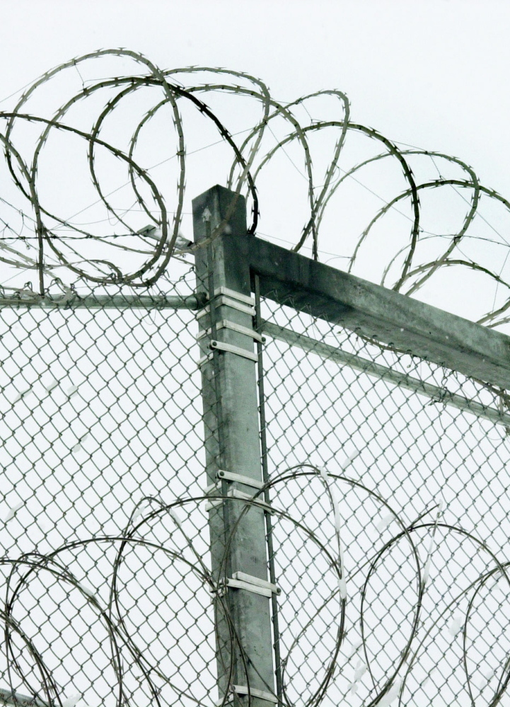 Razor wire tops the fence at the Maine State Prison in Warren. A reader urges working to prevent the high rate of incarceration.