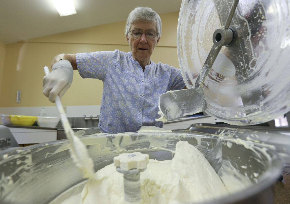 "Sister Patricia mixes cheesecake batter  in Cambridge, N.Y.  ""You make 220 decisions on whether the cakes are baked. ... You need to know the look of each flavor,"" she says."