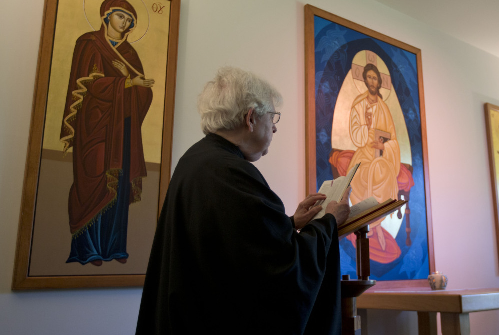 Sister Rebecca reads during a morning prayer service. The nuns of New Skete lead cloistered lives marked by prayer, contemplation and baking high-end cheesecakes.