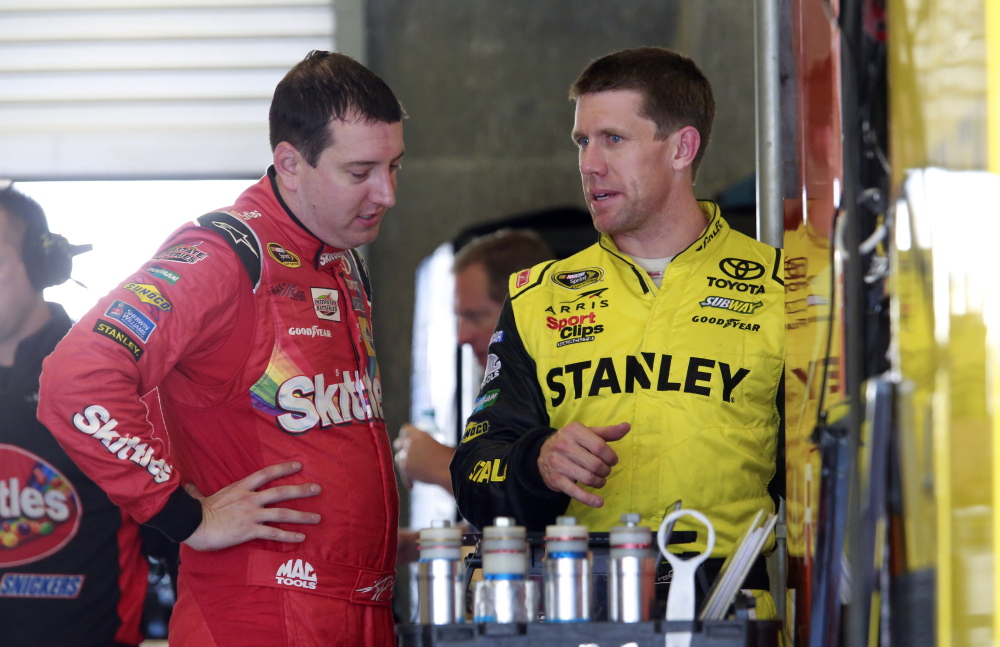 Kyle Busch, left, talks with Carl Edwards during practice for Sunday's Sprint Cup race at Indianapolis Motor Speedway. Jeff Gordon is the defending champion at a track where he has a record five victories.