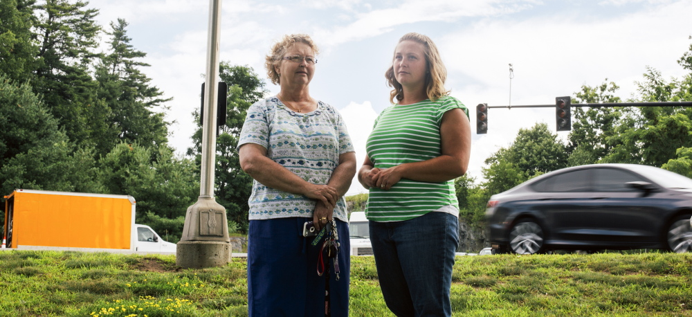 Claudia Stanley, left, and Erika Nielsen stand near the Portland intersection where they helped save a man's life by administering CPR after he crashed into a traffic light pole. Stanley said when she arrived on the scene, which was across the street from where she works at Granite Bay Care, the man was not breathing and had no pulse.