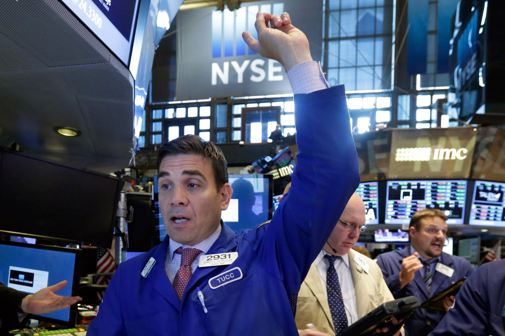 Specialist Robert Tuccillo works at his post on the floor of the New York Stock Exchange on June 30.