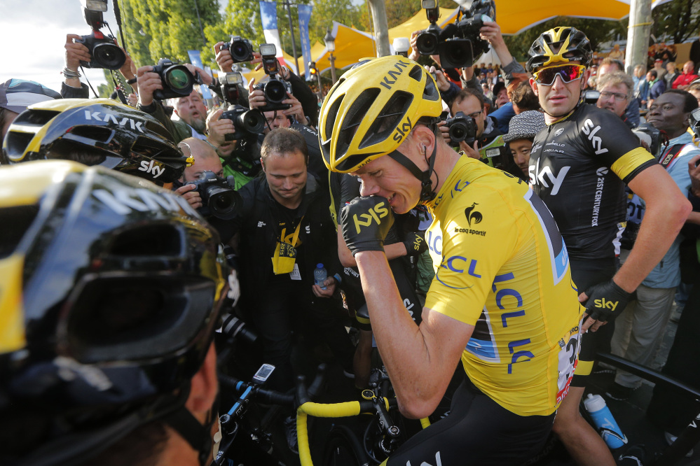 2015 Tour de France cycling race winner Britain's Chris Froome celebrates after the twenty-first and last stage of the Tour de France cycling race over 109.5 kilometers (68 miles) with start in Sevres and finish in Paris, France, Sunday.