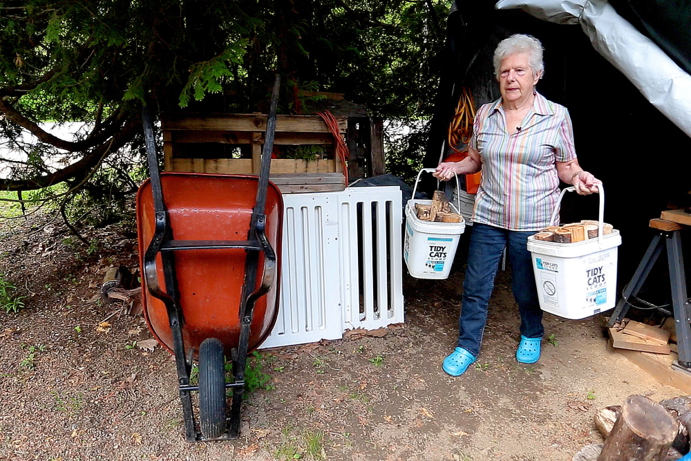 Former professional wrestler Ann Lake, 82, is still going strong, carrying buckets of firewood at her Harpswell home. Growing up on a farm and splitting wood helped give Lake a rugged build that helped her excel in a wrestling career.