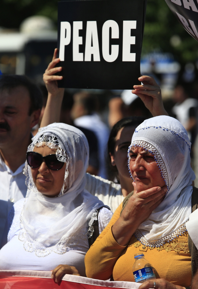 Protesters rally in Istanbul on Sunday. A stretch near Turkey's border with Syria has been outlined to become a protected zone.