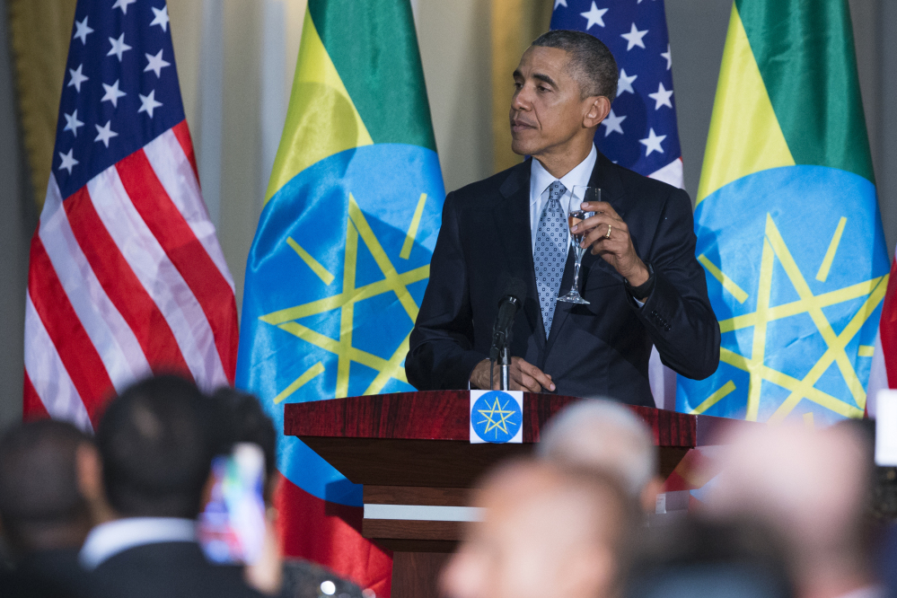 President Obama offers a toast during a state dinner hosted by Ethiopia's prime minister on Monday, He has unleashed a verbal attack on Republican presidential hopefuls.