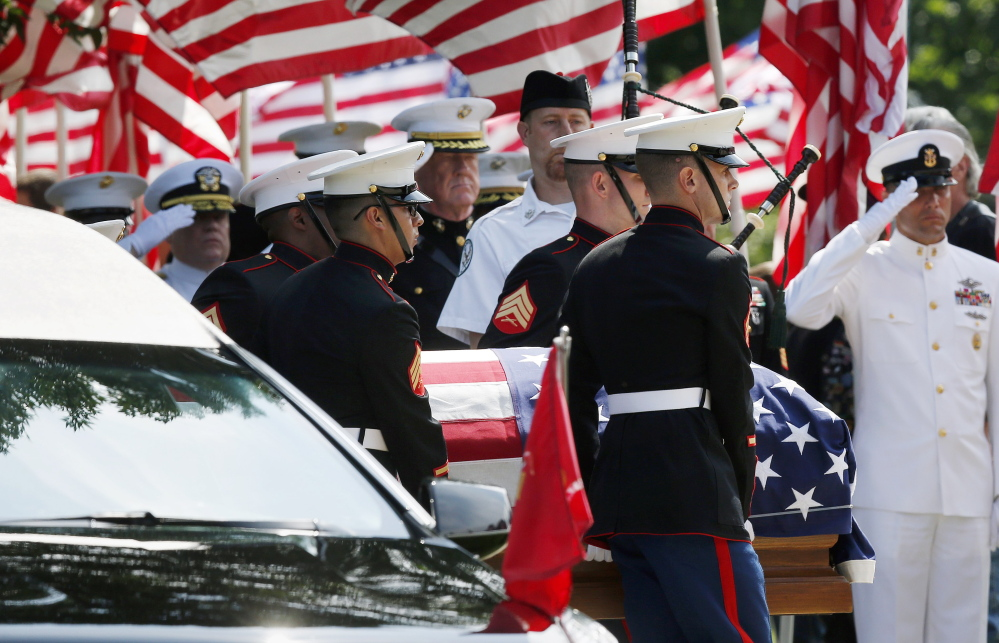 Marine pallbearers carry the casket of Marine Gunnery Sgt. Thomas Sullivan into a funeral service at Holy Cross Church in Springfield, Mass., on Monday. Sullivan was one of five service members slain by a gunman in Chattanooga on July 16.
