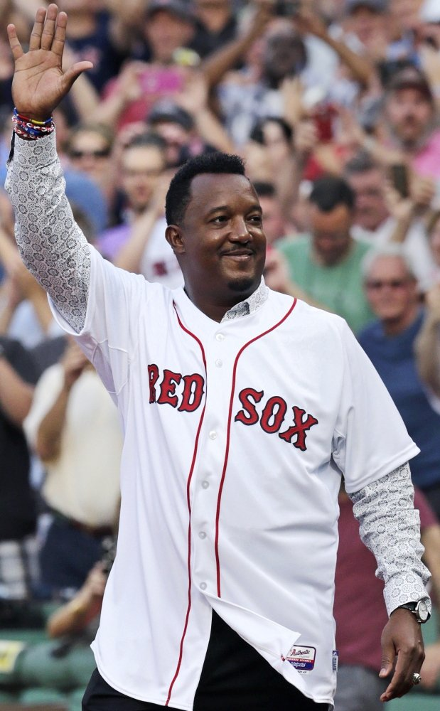 "Pedro Martinez waves to fans during the number retirement ceremony. ""Today I'm extremely fortunate and humbled …"" Martinez told the Fenway Park crowd."