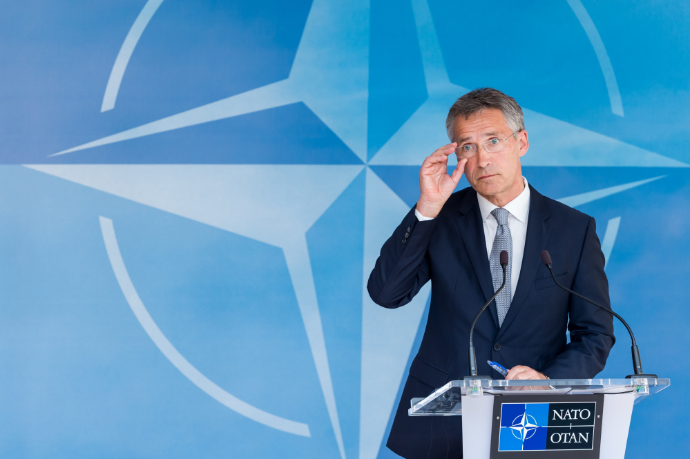 NATO Secretary General Jens Stoltenberg addresses the media after a North Atlantic Council Meeting at NATO headquarters in Brussels on Tuesday.  The Associated Press