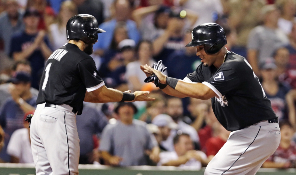 Chicago's Jose Abreu, right, is congratulated by teammate Adam Eaton after his two-run home run off Red Sox starter Wade Miley in the sixth inning Tuesday night.
