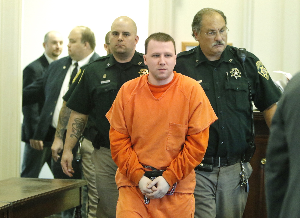 Derek Poulin is escorted into York County Superior Court in Alfred on Tuesday. Justice John O'Neil sentenced Poulin to life in prison for murdering his grandmother in Old Orchard Beach in 2012. Gregory Rec/Staff Photographer