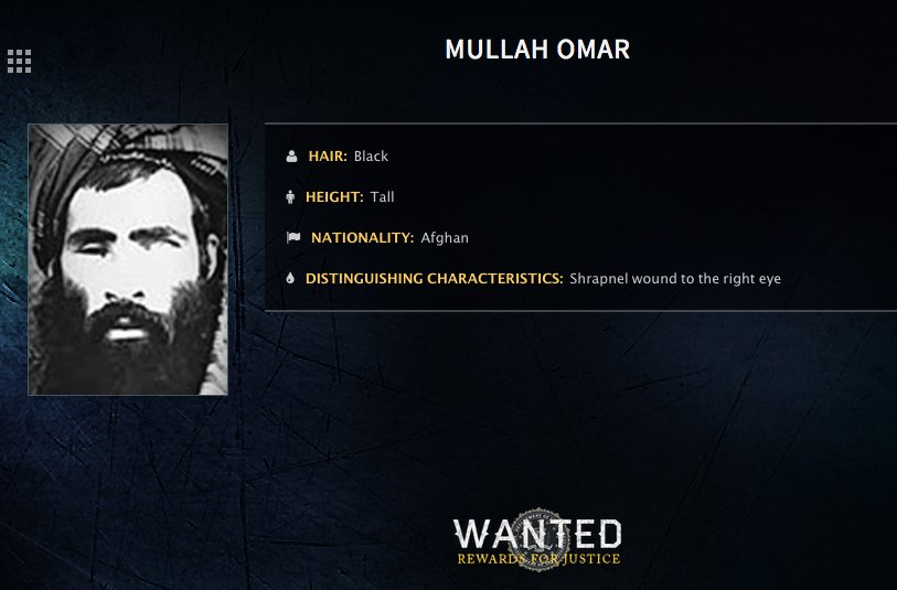 In this undated image released by the FBI, Mullah Omar is seen in a wanted poster. An Afghan official says his government is examining claims that reclusive Taliban leader Mullah Omar is dead.