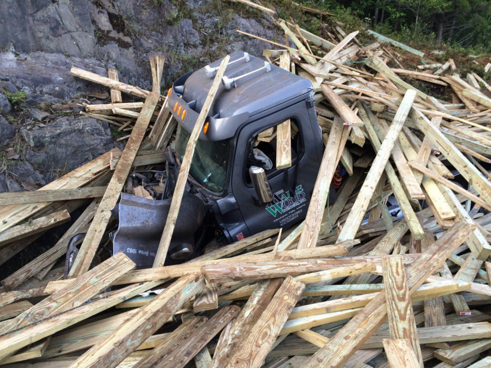 A tractor-trailer loaded with 90,000 pounds of lumber ran off Interstate 95 in Sidney at mile 115 in the northbound lane.