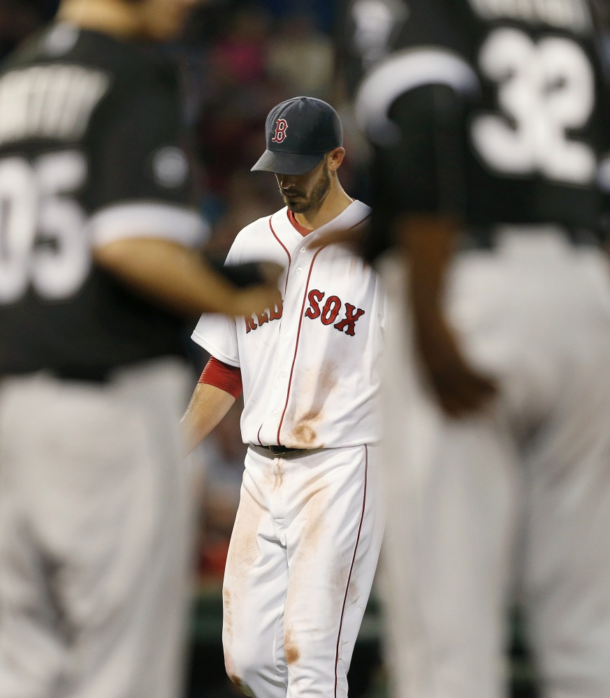 Red Sox starter Rick Porcello leaves the field after being taken out in the third inning of another ineffective start.