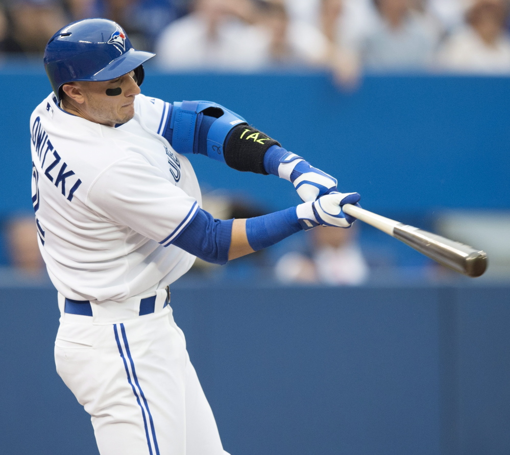 Troy Tulowitzki smacks a two-run home run in his first game with the Blue Jays on Wednesday. Tulowitzki had three hits in the Jays' 8-2 win over the Phils.