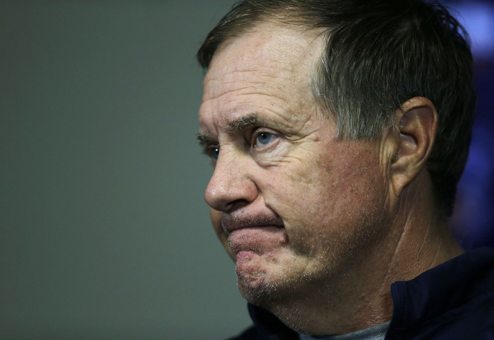 New England Patriots head coach Bill Belichick listens to a question as he meets with the media before the team's first practice at an NFL football training camp Thursday, July 30, 2015, in Foxborough, Mass. Belichick is stonewalling questions about deflated footballs for the second straight day. Belichick said before the team's first practice of training camp on Thursday that he's only worried about the day's practice.