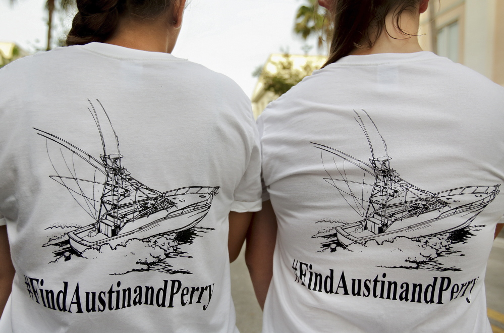Girls wear T-shirts they bought to help fund a private search for two Florida teens who remain missing after their boat was found capsized at sea.