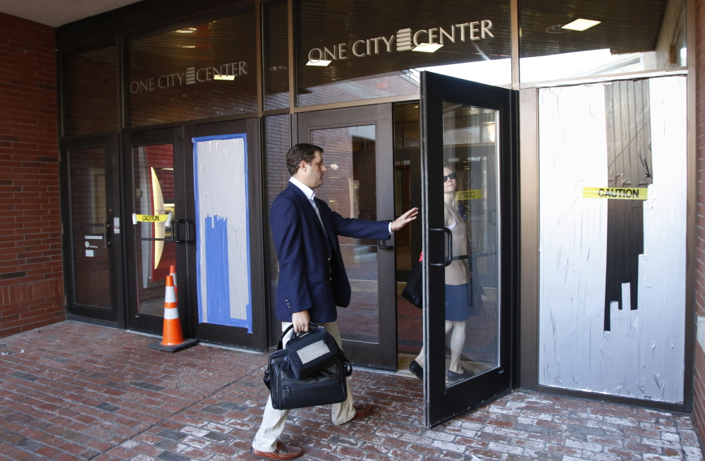 Two doors at One City Center in Portland were damaged early Friday when a man fired four shots from a high-powered pellet gun at an unarmed security guard. Joel Page/Staff Photographer