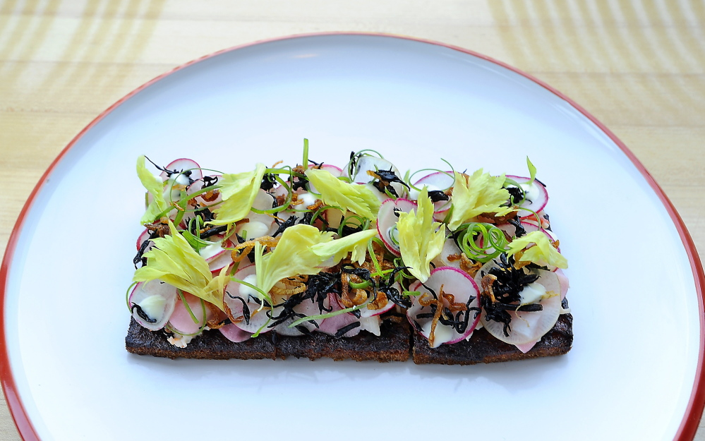 The Honey Paw's lobster tartine with chilled lobster salad, lobster mousse, lemon emulsion, radish and hijiki.
