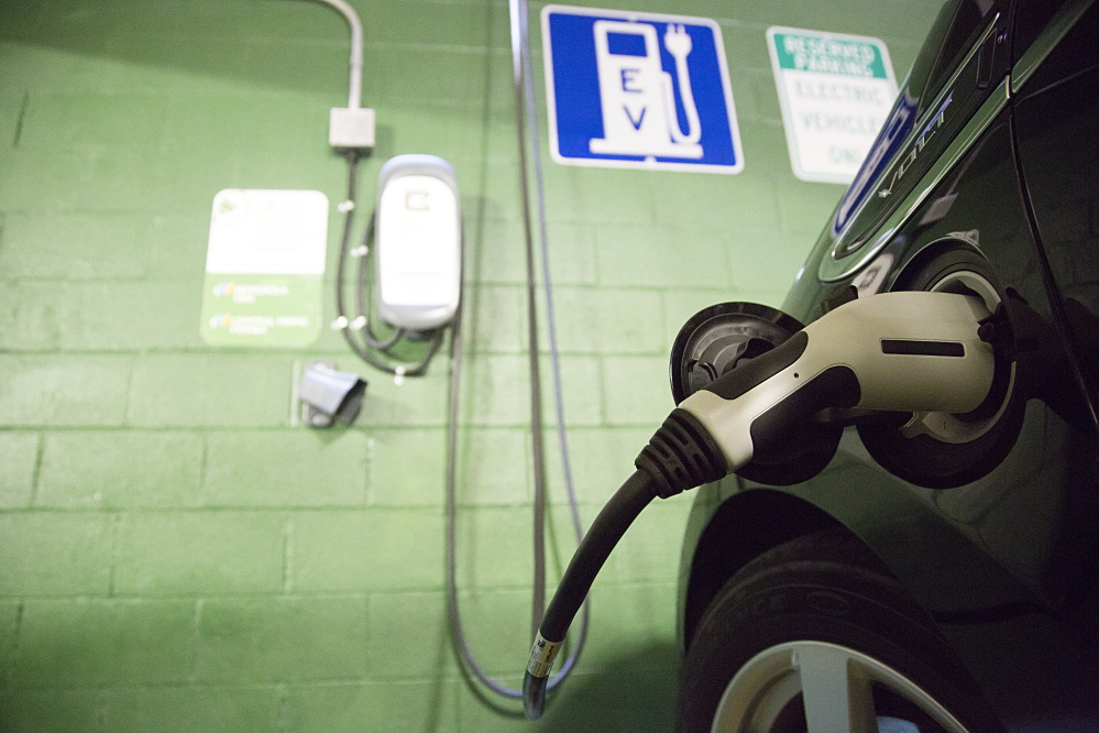 A Chevrolet Volt is plugged in to an electric vehicle charger, one of seven installed in Portland so far.