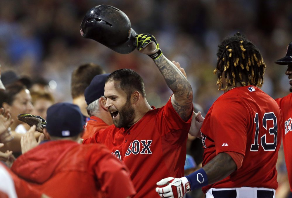 Mike Napoli celebrates his two-run home run in the seventh inning July 31, against the Tampa Bay Rays in Boston.