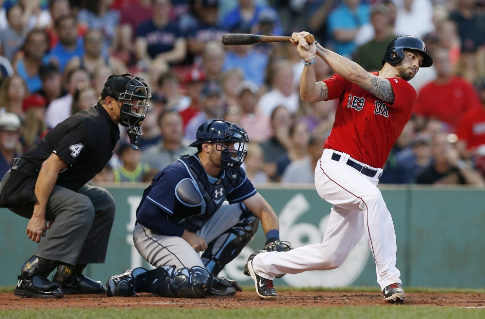 Boston catcher Blake Swihart hits a two-run single in the first inning of Friday night's game. Swihart also doubled in the eighth inning, then scored on a wild pitch to give Boston a 7-5 lead.