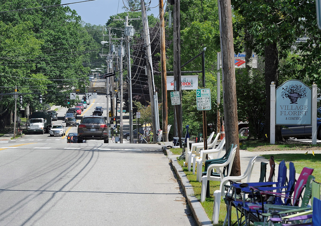 Chairs line Yarmouth's Main Street to save space for spectators at the Yarmouth Clam Festival parade. A replacement overpass will soon carry Route 1 over Main Street. 2015 Press Herald file photo/Gordon Chibroski