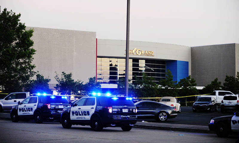 Law enforcement and other emergency personnel respond to the scene of the deadly shooting at the Grand Theatre in Lafayette, La.