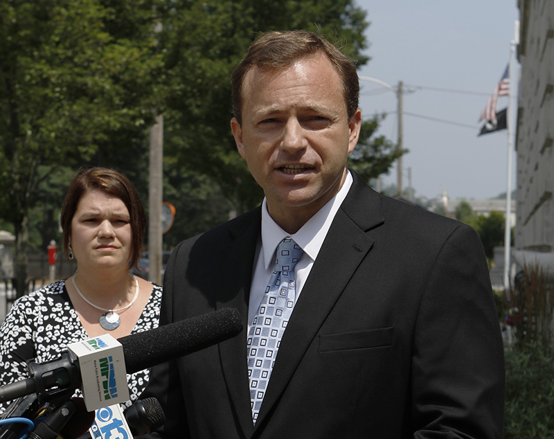 Maine House Speaker Mark Eves, joined by wife Laura, left, speaks outside of the federal courthouse in Portland about his lawsuit filed Thursday against Gov. Paul LePage.