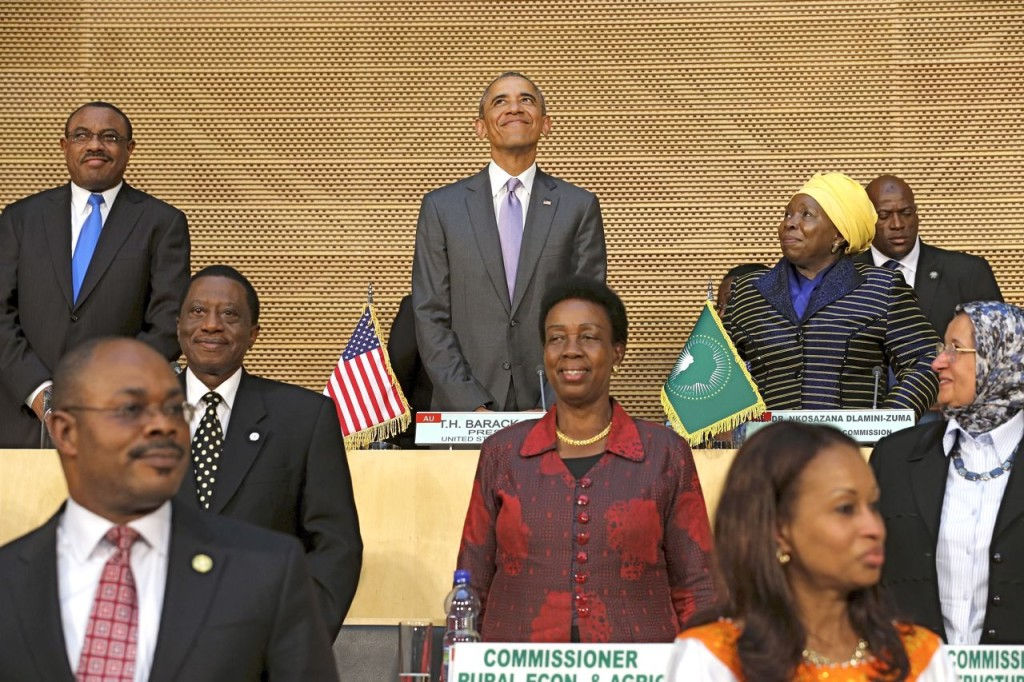 President Obama, flanked by Ethiopia's Prime Minister Hailemariam Desalegn, top left, and African Union Chairwoman Nkosazana Dlamini-Zuma, arrives to deliver remarks at the African Union in Addis Ababa, Ethiopia, Tuesday. Reuters