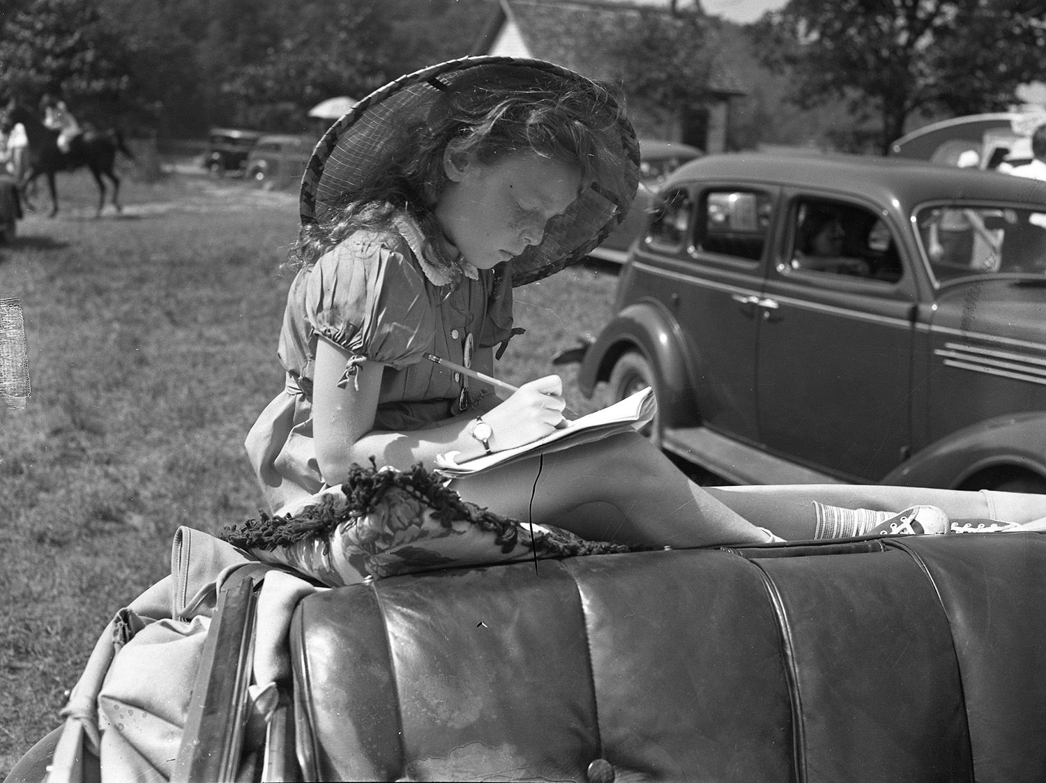 Marcia Corliss, of Sunapee, NH. sits in automobile jumpseat at Harrison Horse Show, Aug. 5, 1938. From the Portland Public Library archival collection of Portland Press Herald, Maine Sunday Telegram and Evening Express photos.